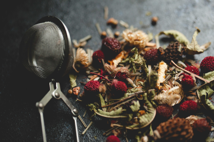 tea, strawberries, dried, home made, home made tea, dried leaves, dried herbs, food photography, food photographer, low light, food stylist, pretty, reds and greens, natural, healthy living,